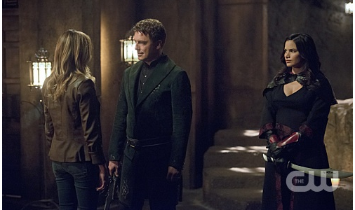 "Arrow -- ""Restoration"" -- Image AR403B_0048b.jpg -- Pictured (L-R): Katie Cassidy as Laurel Lance, John Barrowman as Malcolm Merlyn and Katrina Law as Nyssa al Ghul -- Photo: Diyah Pera /The CW -- © 2015 The CW Network, LLC. All Rights Reserved."