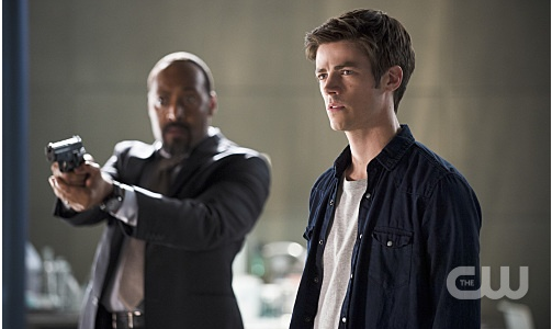"The Flash -- ""The Man Who Saved Central City"" -- Image FLA201b_0429b.jpg -- Pictured (L-R): Jesse L. Martin as Detective Joe West and Grant Gustin as Barry Allen -- Photo: Cate Cameron /The CW -- © 2015 The CW Network, LLC. All rights reserved."
