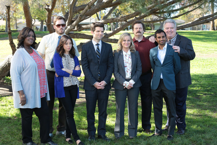 Donna (Retta), Andy (Chris Pratt), April (Aubrey Plaza), Ben (Adam Scott), Leslie (Amy Poehler), Ron (Nick Offerman), Tom (Aziz Ansari), and Garry (Jim O'Heir) take one final group shot together as Parks employees. Photo by NBC.